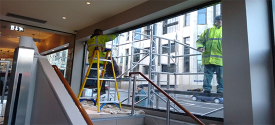 Our Team working on a shop front glazing repair project
